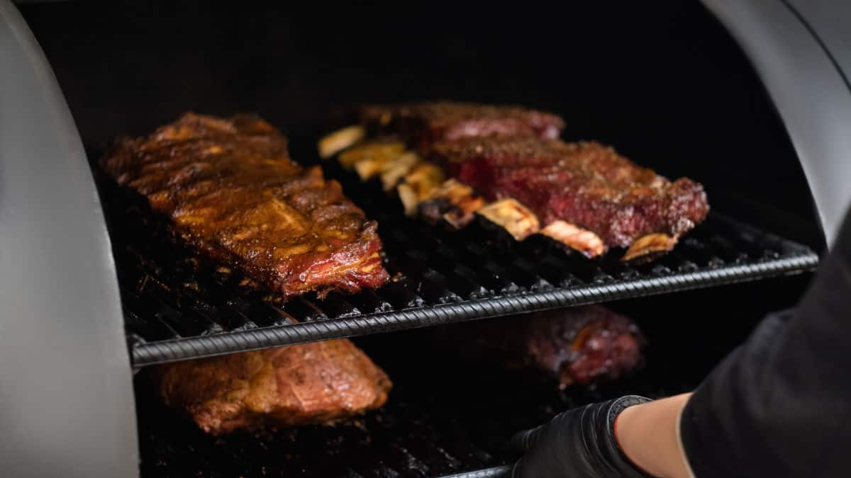 Ribs barbecuing smoking in a large smoker