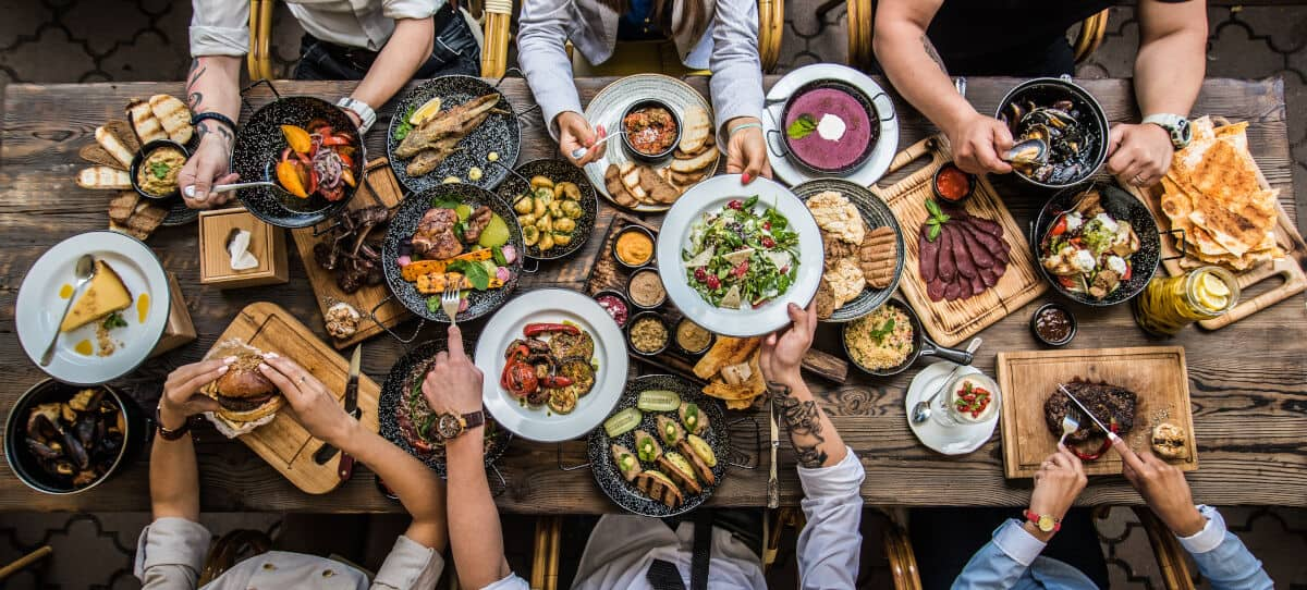 Overhead shot of a large spread of food at a cookout