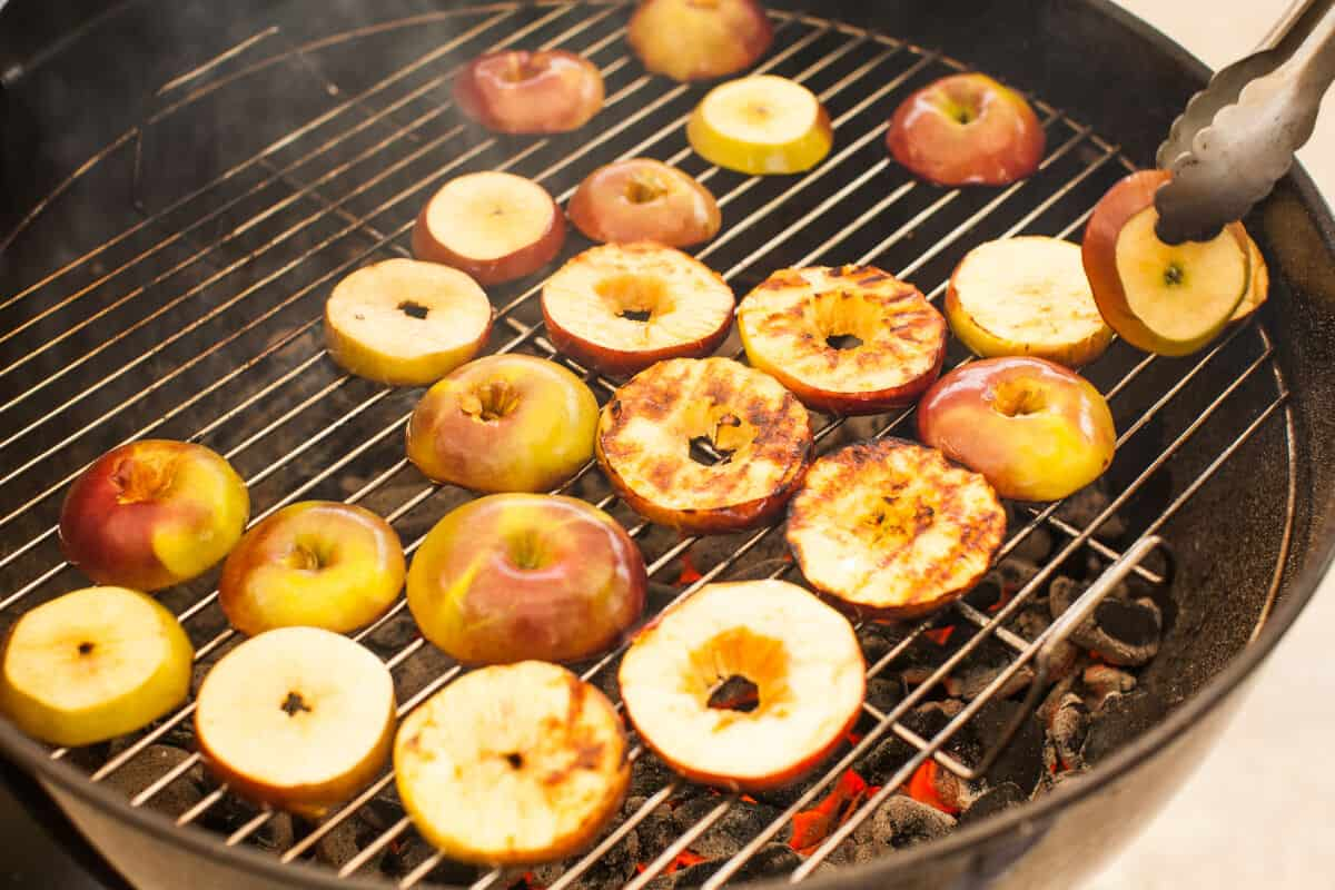 Apple and pineapple on an outdoor grill