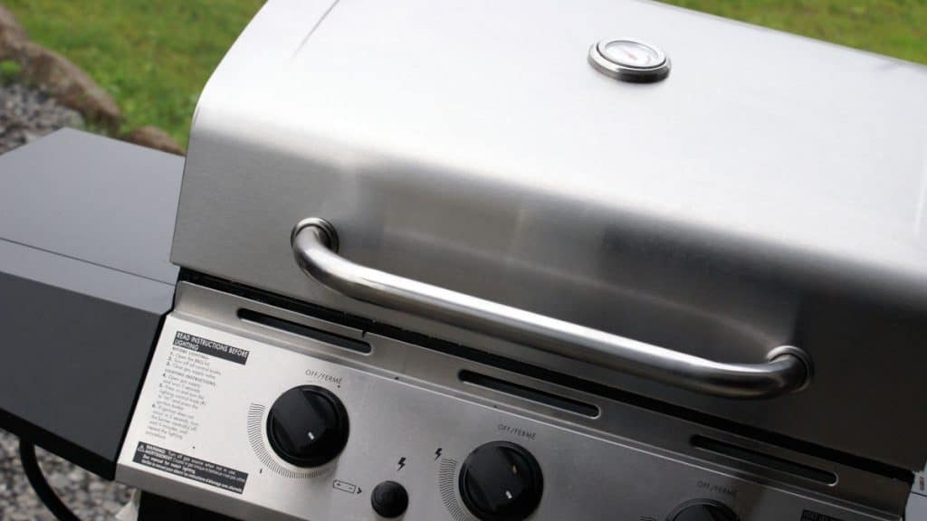 Close up of a gas grill with the lid closed