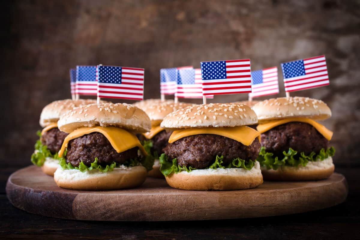 Cheeseburgers with american flags stuck in them