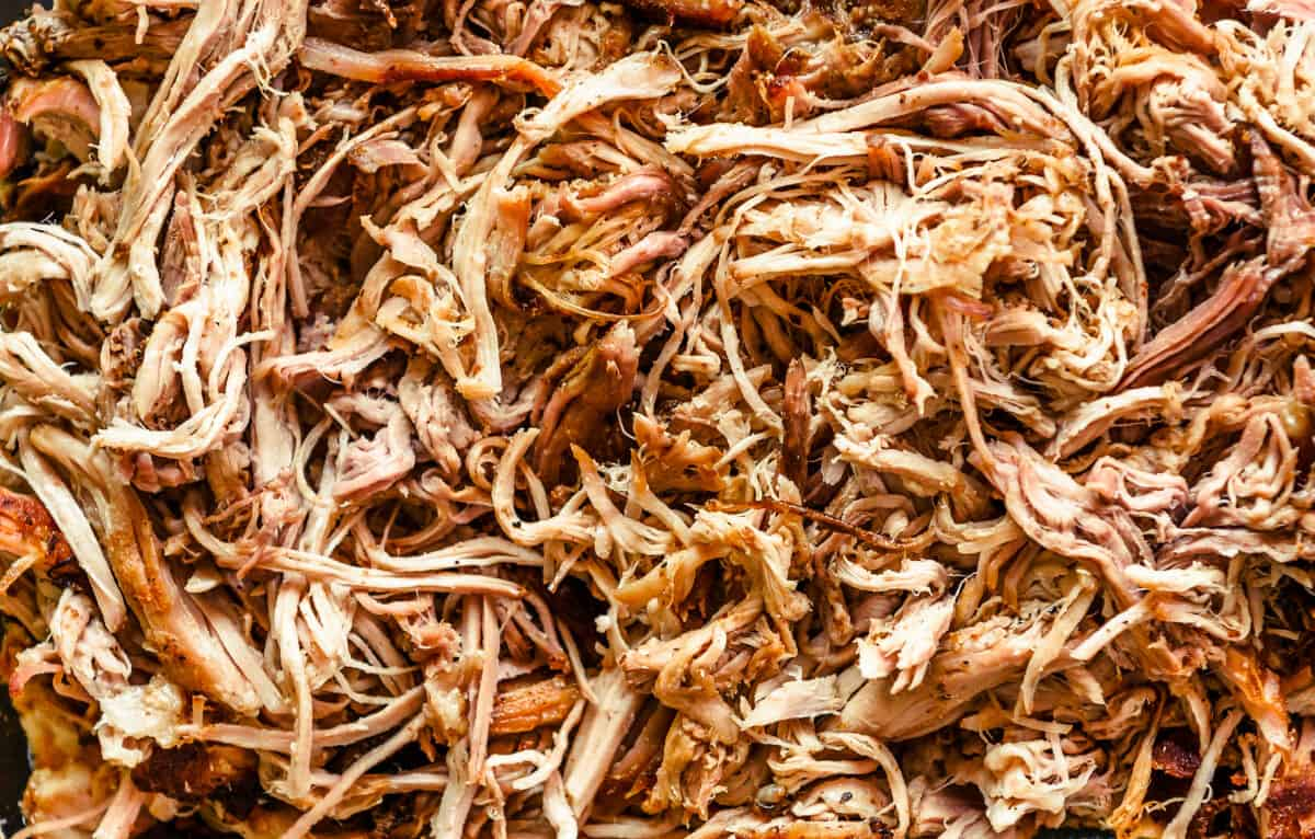 a large tray filled with pulled pork