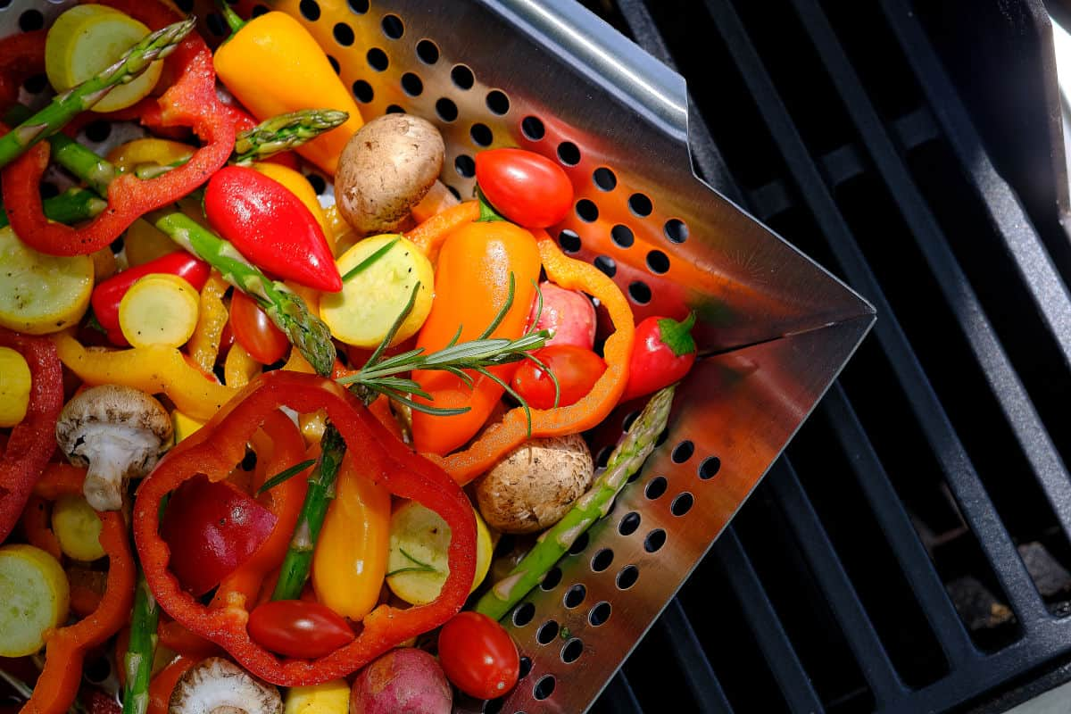 Lots of colorful vegetables in an open grill basket