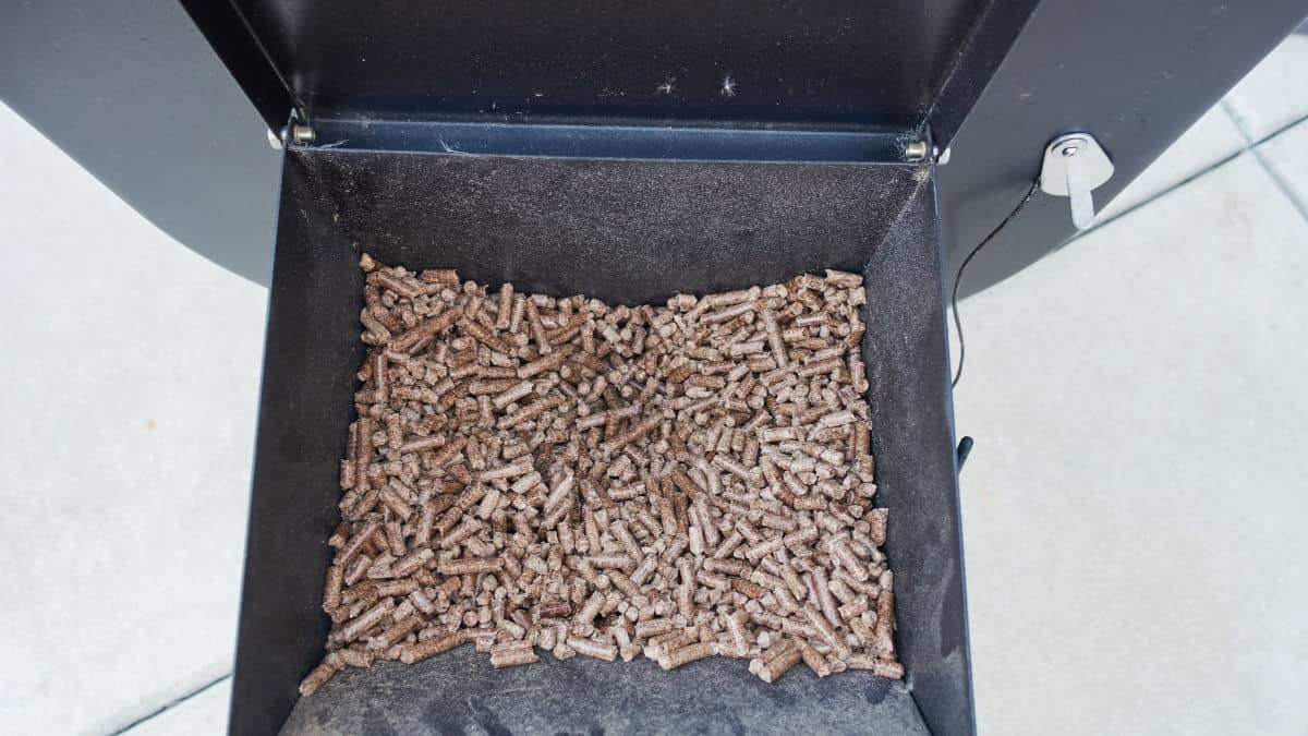 Wood pellets in the hopper of a portable pellet grill