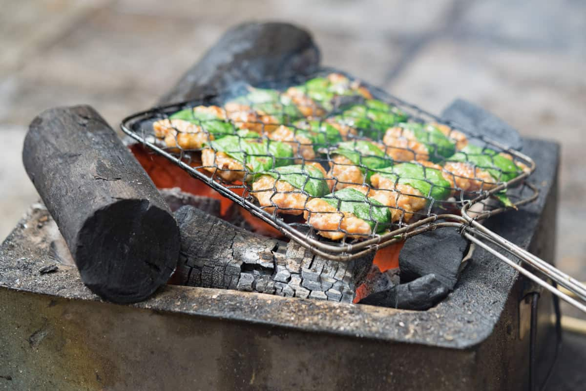 Leaf wrapped chicken in a grill basket