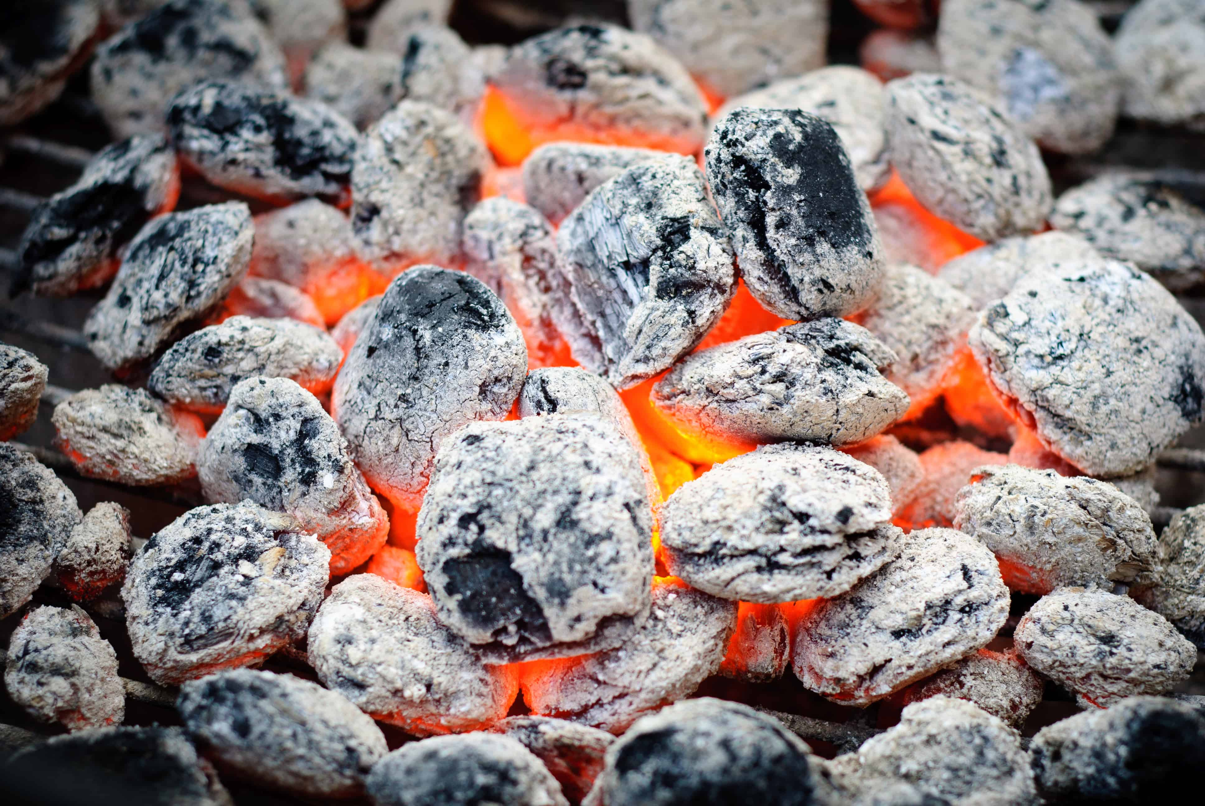 Close up of some red hot, ashed over burning briquettes
