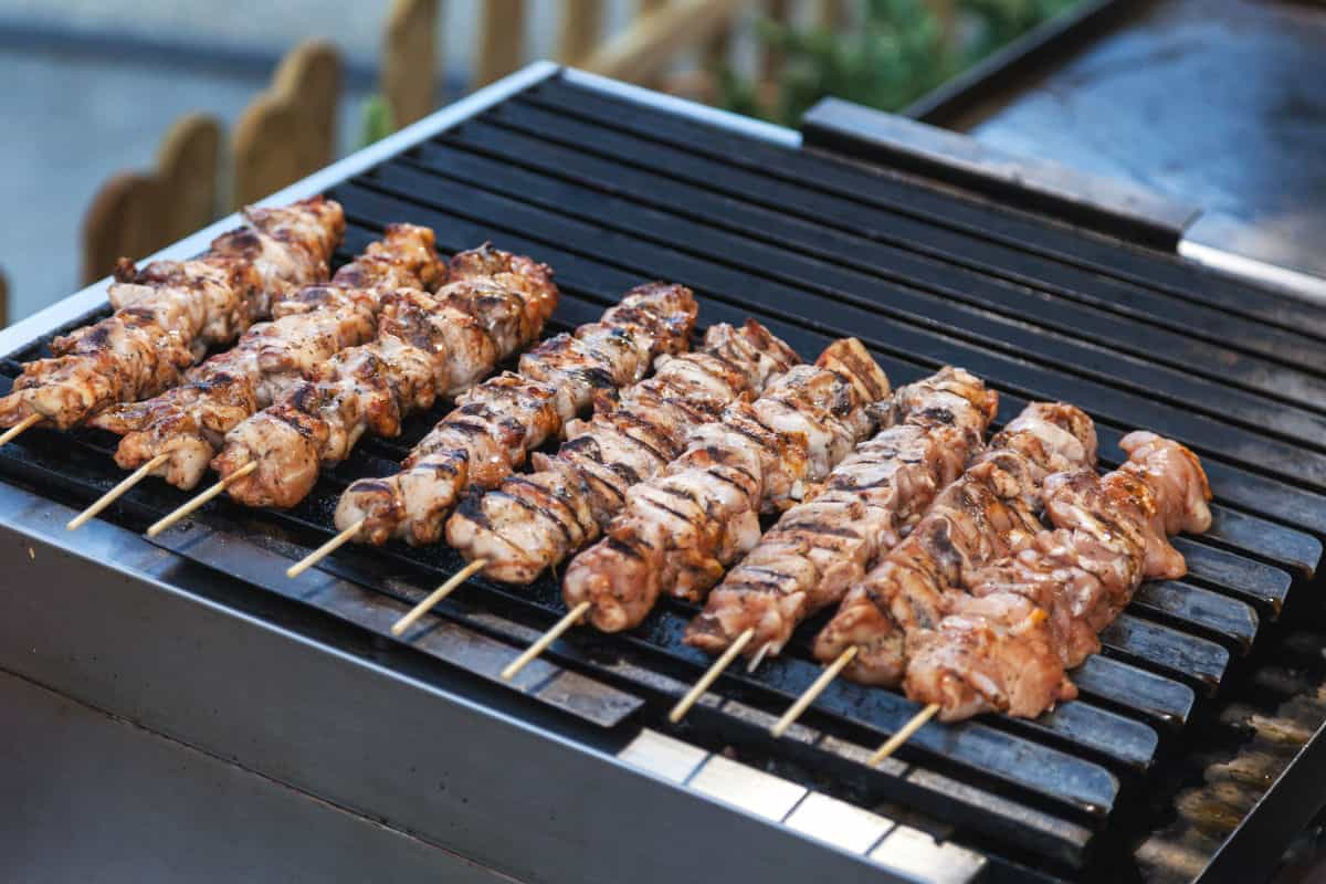 kebobs being grilled on an outdoor electric grill